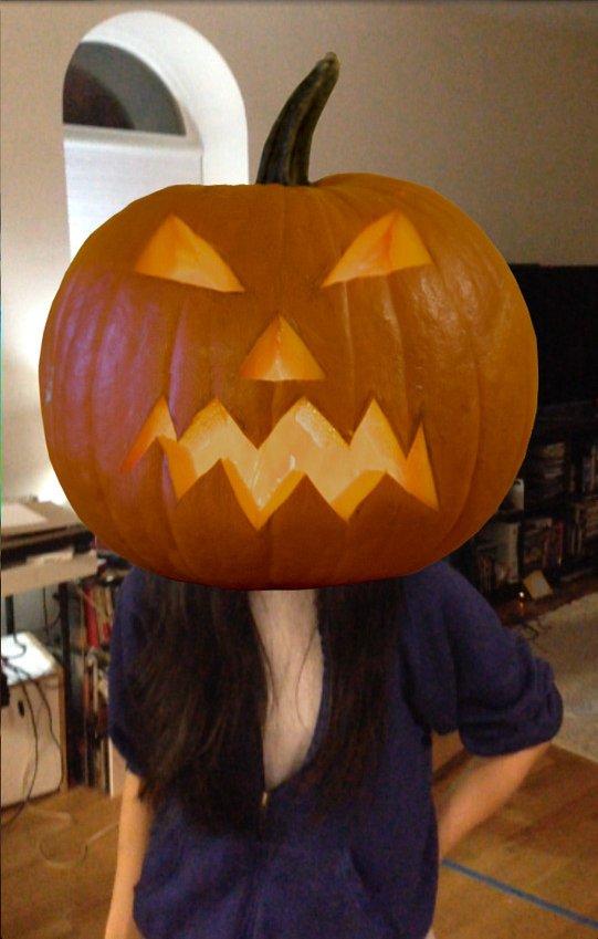 A pumpkin-head virtual mask