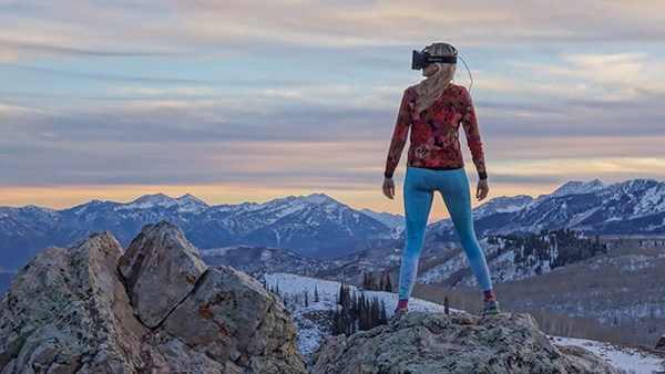 Woman wearing Oculus Rift in nature scene