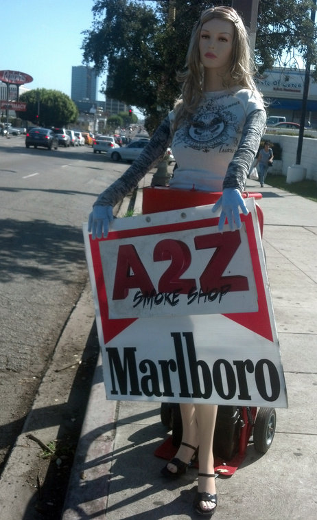 A mannequin sign-spinner