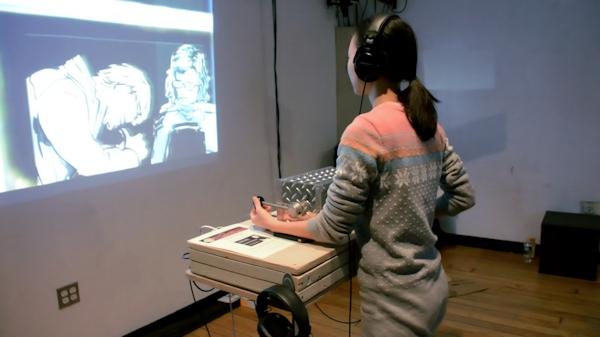 Woman using Subway Stories interactive installation