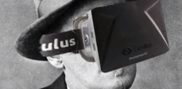 Black and white image features man wearing a hat and an Oculus Rift headset