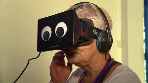 Woman trying BBC VR at Commonwealth Games