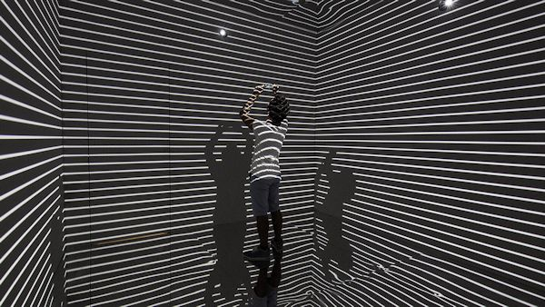 "A person in the ""Infinity Room"" installation"