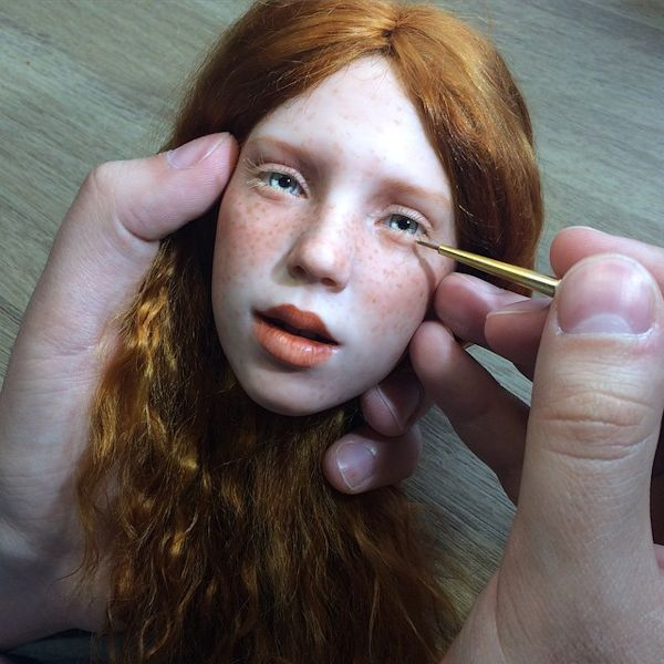 Michael Zajkov paints a realistic-doll head
