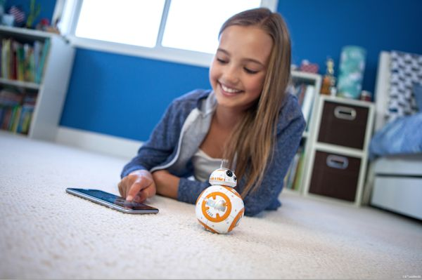 Girl uses phone to interact with BB-8
