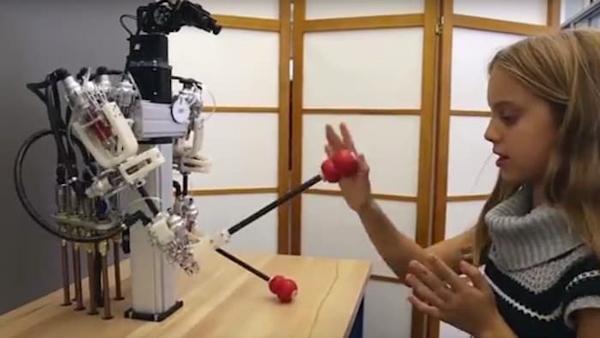 Disney's hybrid telepresence robot plyaing patty cake