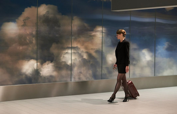 Woman walking by Beyond at Schiphol Airport
