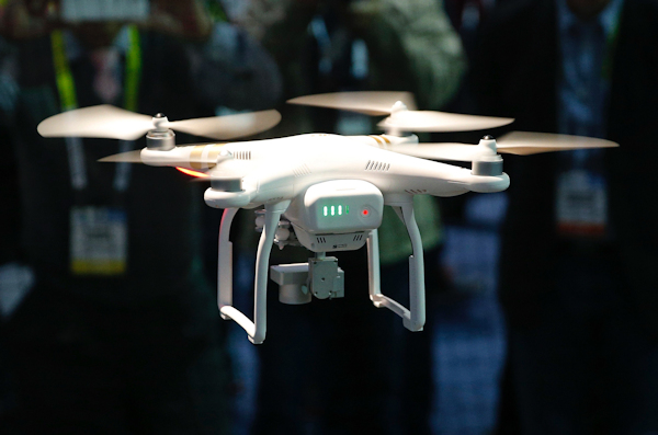 A drone hovers at a booth during CES 2016