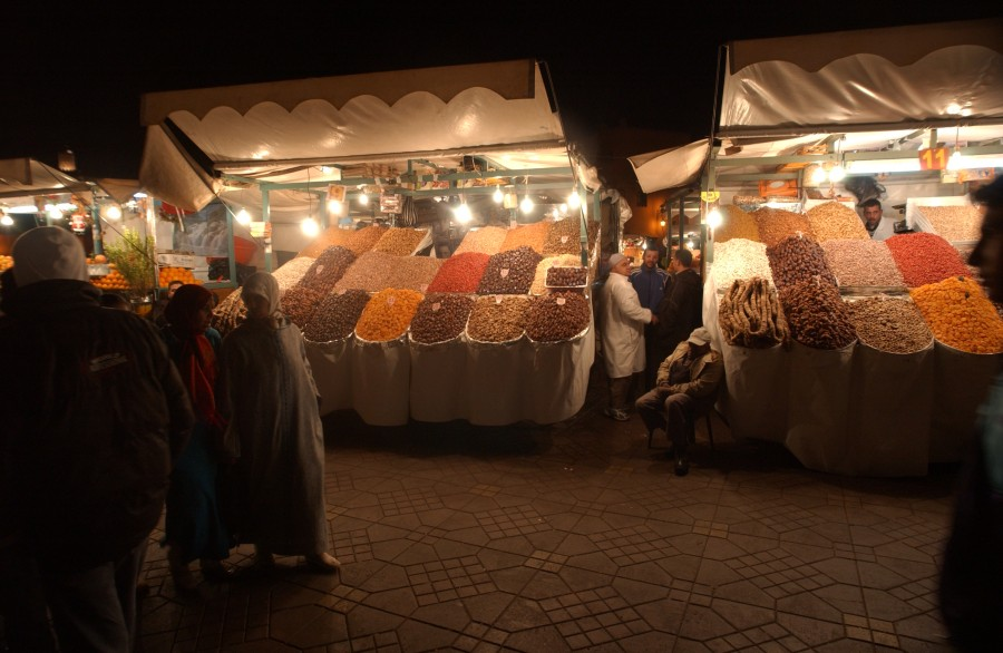 Strollers, night market, Djemaa el Fna, Marrakesh, Morocco.  January 2008.