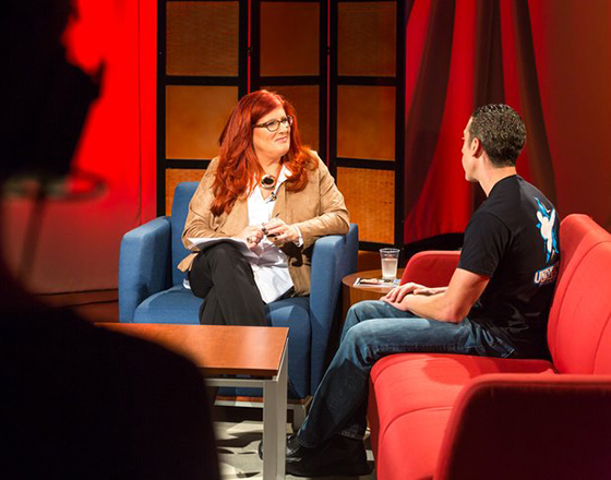 Host Lisa Bien, left, speaks with guest Mark Moore